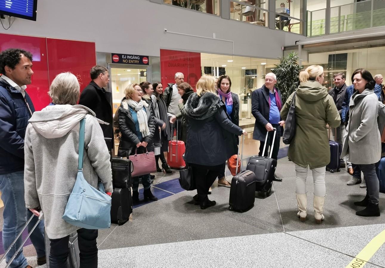Deelnemers op het vliegveld